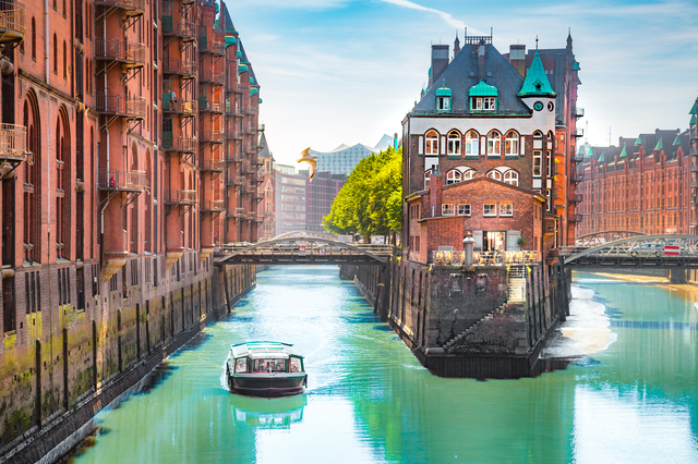 Hamburg Speicherstadt warehouse district with sightseeing boat in summer, Germany